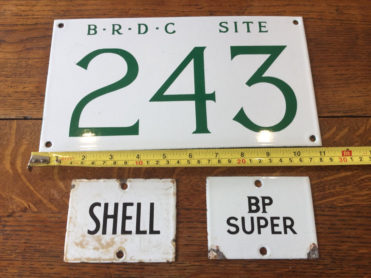 A small collection of motoring enamel signs For Sale (picture 1 of 1)