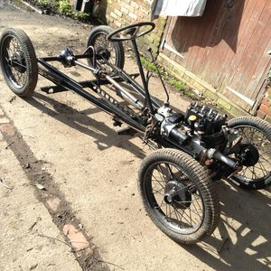 Rebuilt rolling chassis and log book.