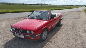 1986 BMW 325i convertible, manual + black leather.