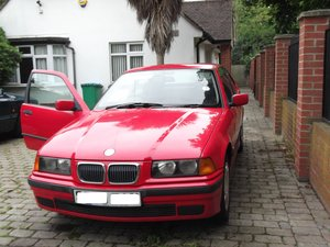 Bright red 3 dr compact 1998 full service history For Sale