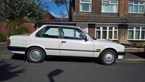 BMW E30 316i 1990 Alpine white with Indigo cloth. SOLD