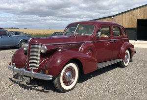1938 MAROON BUICK ROADMASTER SEDAN RHD