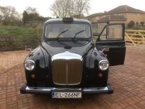 Wedding-ready, highly customised London Taxi