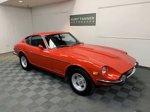1971 Datsun 240 z sports coupe. Monte carlo red