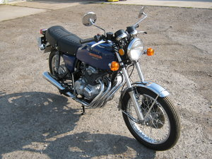 1977 HONDA 400 FOUR SUPER SPORT. ONLY 1 OWNER AND 8K MILES SOLD