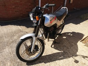 Honda cb125t superdream.  With a box of Honda part