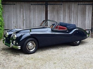 1957 Jaguar XK140 DHC. Restored and improved.