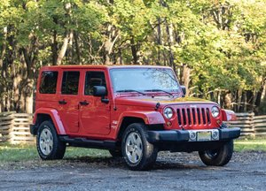 2012 Jeep Wrangler Unlimited Sahara 4X4 in Flame Red Clear C