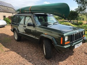 Picture of 1997 Jeep Cherokee Limited 4.0 c/w Canoe at Morris Leslie Auction SOLD by Auction