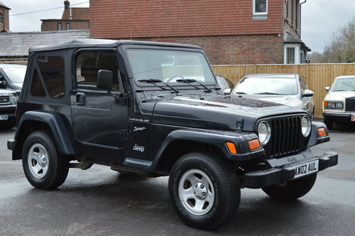 JEEP WRANGLER 2.5 SOFT TOP CONVERTIBLE 4WD + 2002 + LHD SOLD (picture 1 of 3)