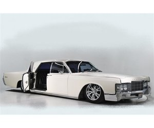 1969 Lincoln Continental on suicide slabs air ride.