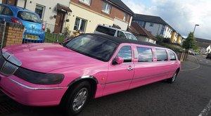 Beautiful pink Linciln Town Car 2000