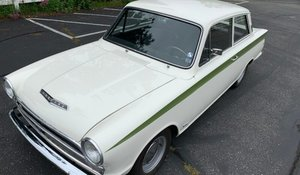 1967  Lotus Cortina Coupe = clean solid Ivory driver  $65k