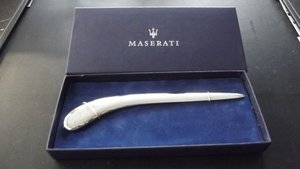 0000 MASERATI TYRES, CUFFLINKS, LETTER OPENER FOR SALE