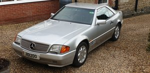 1993 SL 320. 2 Owners, 57k miles.  Silver,  dark blue leather....