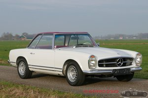 1965 Mercedes Benz 230 SL with a 3rd seat!