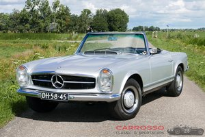 Mercedes Benz 230SL with a 3rd seat!