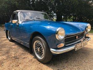 1972 MG Midget 1275cc. Teal blue. Great fun.