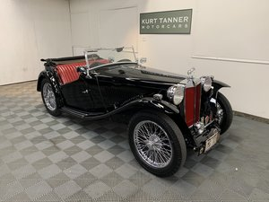 1948 mg tc roadster. Black with red trim.
