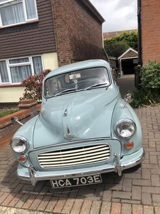 Pretty smoke grey Morris Minor.