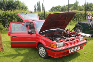 1988 Red modern Nissan classic 5 door hatchback