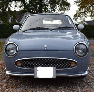 J reg Nissan Figaro in Lapis Grey.