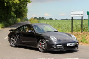 Porsche 911 997 Turbo, 2010. Basalt Black metallic.