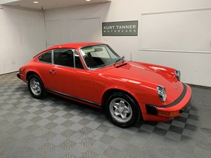 Porsche 911 s coupe. Guards red with black