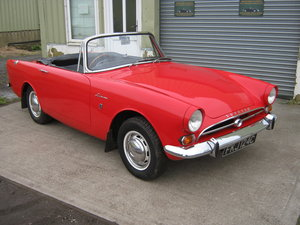 1965 SUNBEAM ALPINE SERIES 4 1600CC. CARNIVAL RED. OVERDRIVE SOLD