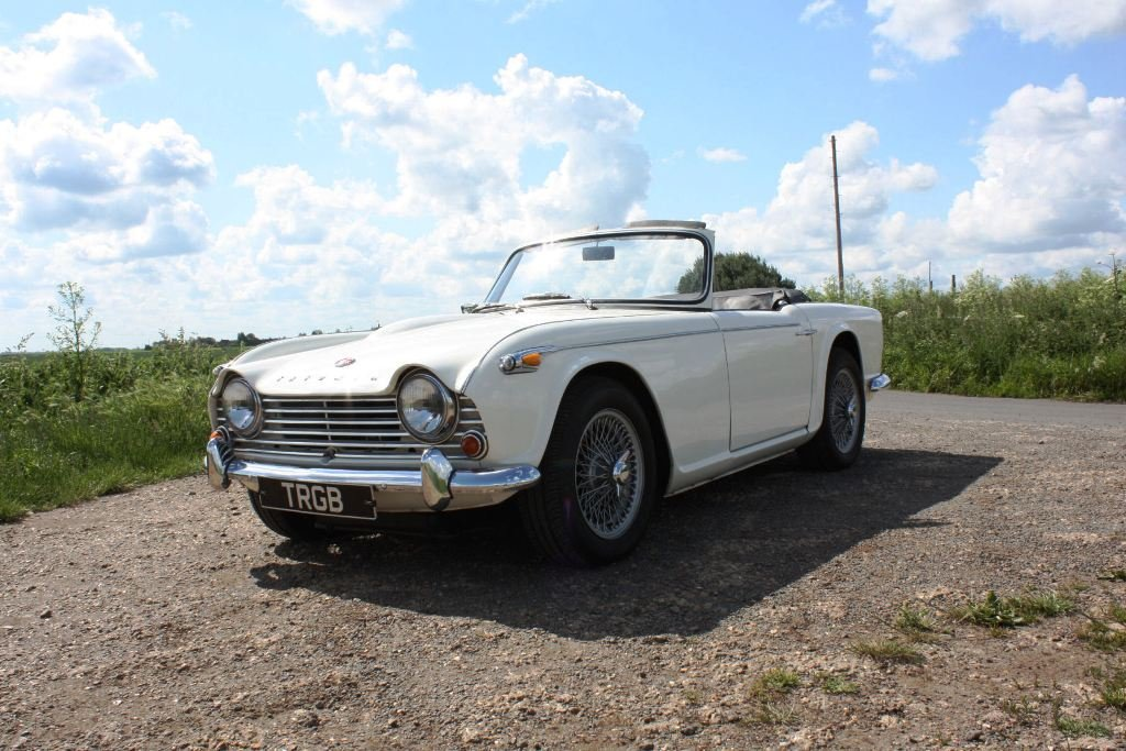 1965 TR4A. WHITE WITH BLACK INTERIOR AND OVERDRIVE SOLD (picture 1 of 6)