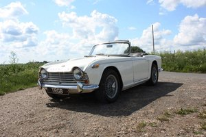 1965 TR4A. WHITE WITH BLACK INTERIOR AND OVERDRIVE SOLD