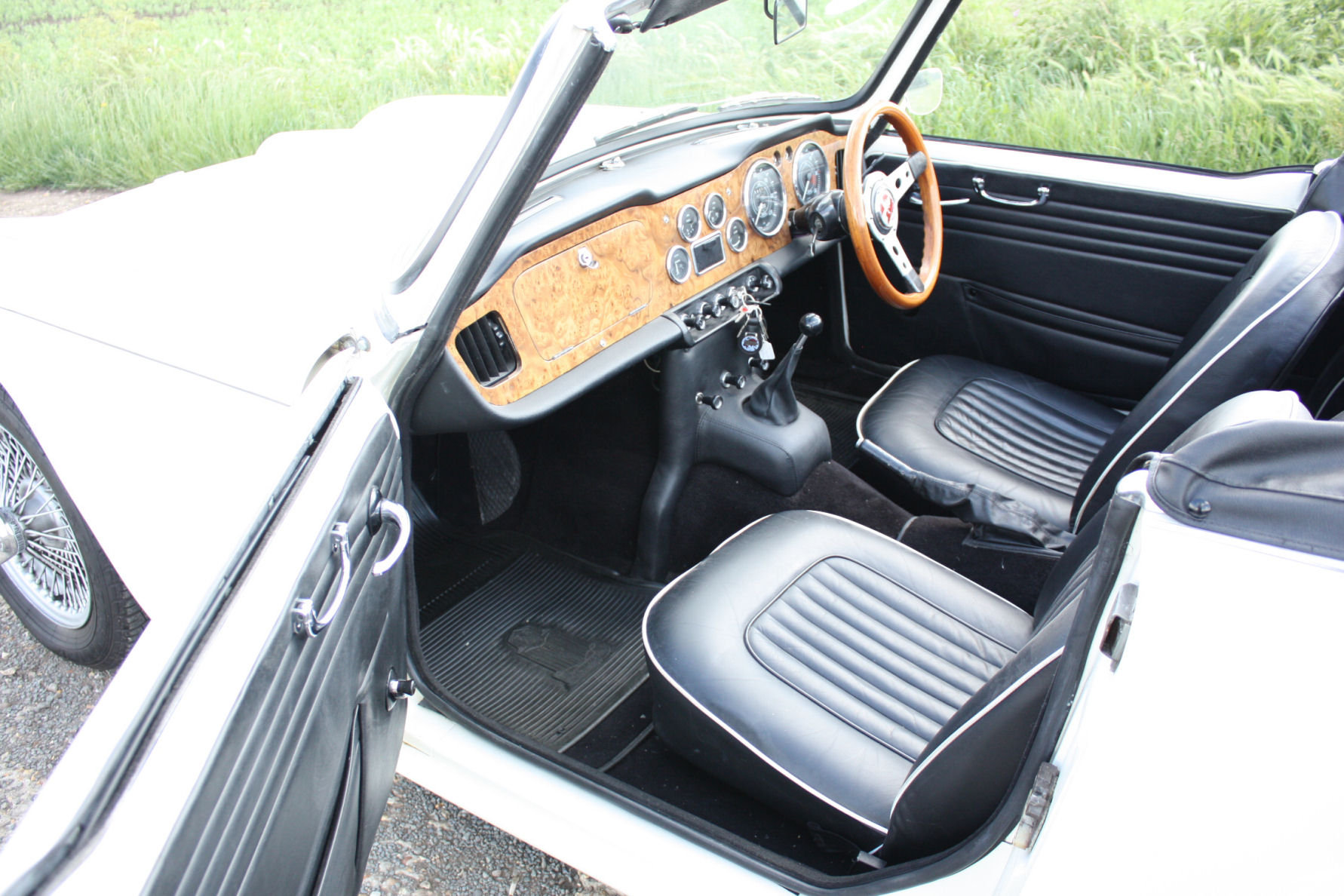 1965 TR4A. WHITE WITH BLACK INTERIOR AND OVERDRIVE SOLD (picture 2 of 6)