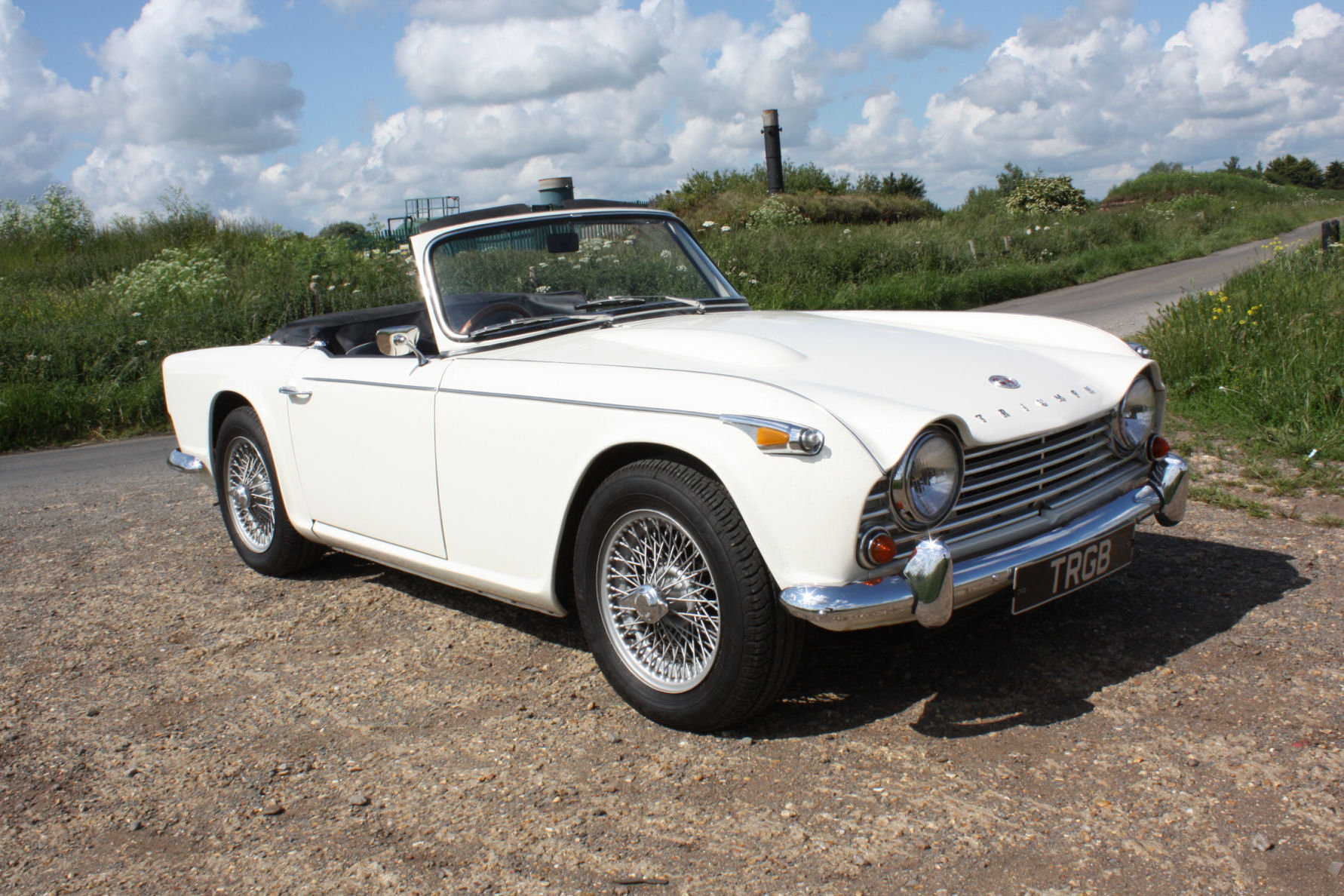 1965 TR4A. WHITE WITH BLACK INTERIOR AND OVERDRIVE SOLD (picture 5 of 6)