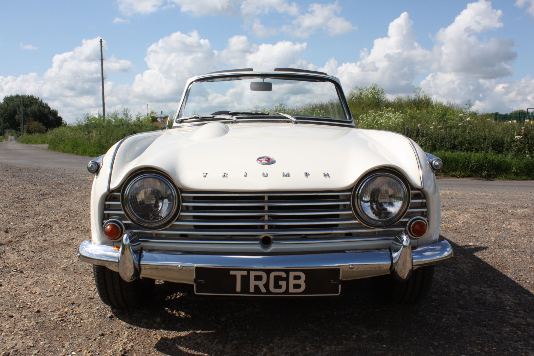 1965 TR4A. WHITE WITH BLACK INTERIOR AND OVERDRIVE SOLD (picture 6 of 6)
