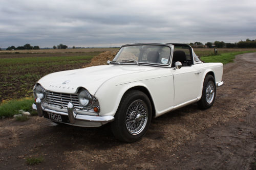 TRIUMPH TR4 1962. ORIGINAL UK CAR WITH OVERDRIVE AND SURREY  SOLD (picture 1 of 6)