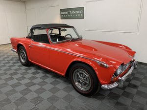1968 Triumph tr250 convertible. Signal red