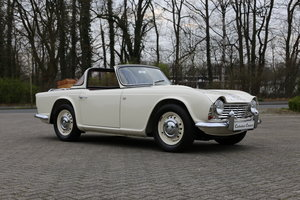1963 An uncompromising frame off TR4 restoration with Surrey Top SOLD