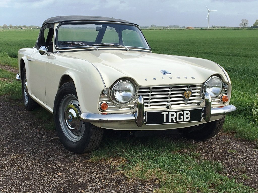 TR4 1963 WHITE WITH BLACK INTERIOR. SOLD (picture 1 of 6)