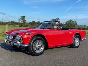 1967 Triumph TR4A IRS. Signal red with Black leather interio