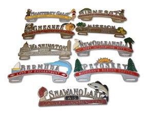 Nine Cast Aluminum License Plate Attachments For Sale by Auction