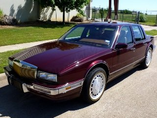 1990 Cadillac Seville STS Sedan low 66k miles Maroon $14.9k For Sale